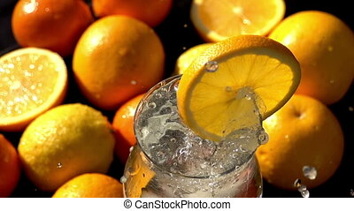 Falling Ice Cubes in a Citrus Drink - Ice cubes falling into...