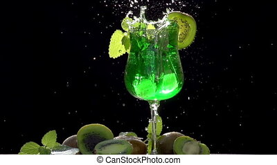 Ice Falls in Cocktail with Kiwi and - Glass decorated with a...