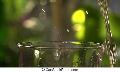 Poured Sparkling Wine Closeup - Champagne being poured into...