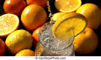 Mineral Soda with a Slice of Orange - In a glass poured...