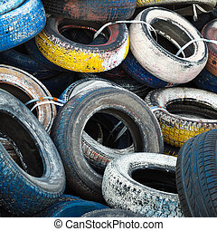 pile of old colored tires
