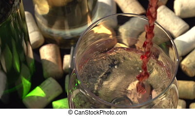 Red Wine Being Poured into a Glass - The camera moves over a...
