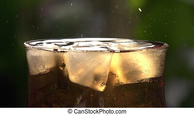In a Glass with Ice Drops Fall