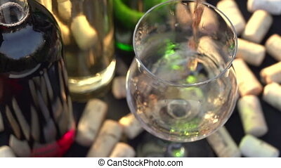 Pink Wine is Poured into a Glass - The camera moves over a...