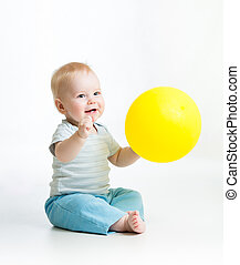 Smiling baby boy with yellow ballon in his hand - Smiling...