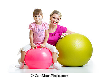 kid and mother with fitness ball - kid girl and mother with...