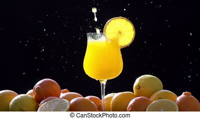 Intensively Pouring Orange Juice - In a glass of orange...