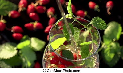 Soda with Mint and Strawberries - In a glass with...