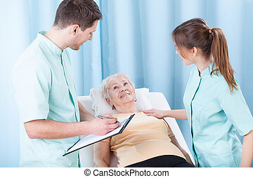 Lady lying on hospital bed