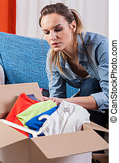 Wife packing clothes because of moving house