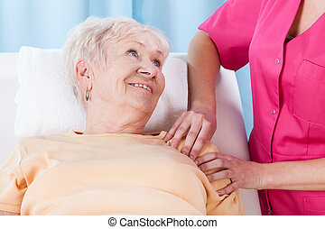 Elderly lady during rehabilitation