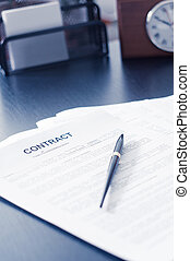 Contract on wooden desk with clock and fountain pen -...
