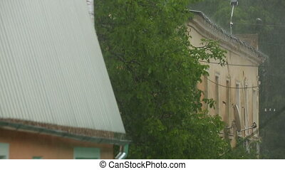 Over Flowing Rain In the City - Shot of the houses in the...
