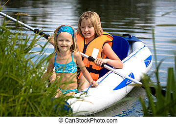 two young girls boating on the lake - two young girls...