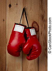 Hangin em up - A pair of red boxing gloves hangs from a nail...
