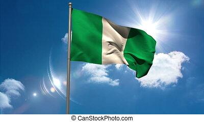 Nigeria national flag waving on flagpole on blue sky...