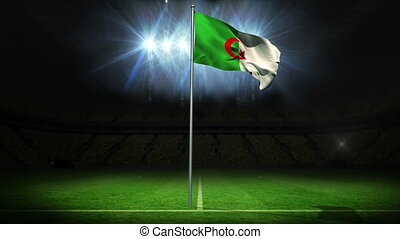 Algeria national flag waving on flagpole against football...