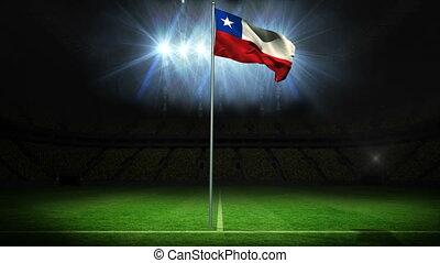 Chile national flag waving on flagpole against football...