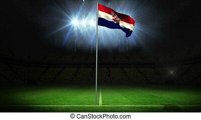 Croatia national flag waving on flagpole against football...