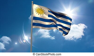 Uruguay national flag waving on flagpole on blue sky...