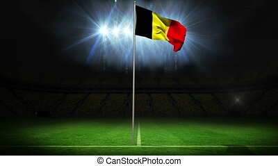 Belgium national flag waving on flagpole against football...
