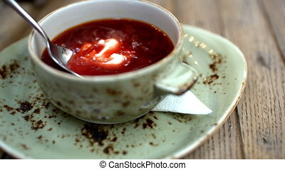 Borsch with sour cream served in cafe - Close-up shot of...