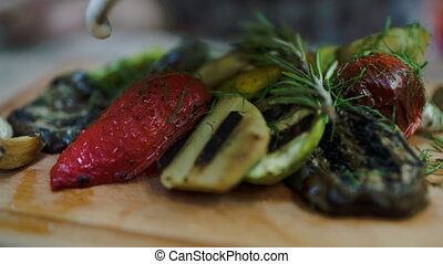 Sauce topping on grilled vegetables - Close-up shot of cream...