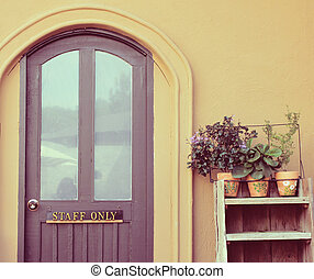 Staff only on door with flower pot for decorated, retro...