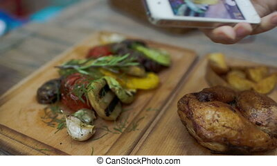 Taking picture of dish served in cafe - Close-up shot of...