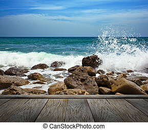 Rocks in the waves and sea foam. - Rocks in the waves and...