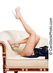 Close-up of woman trying high heels - Close-up of woman legs...