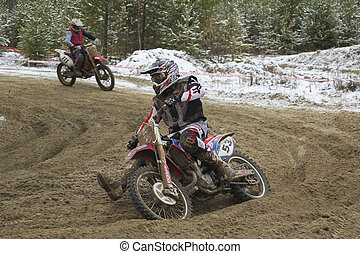 Motocross. - A man on a motorcycle racing at high speed.