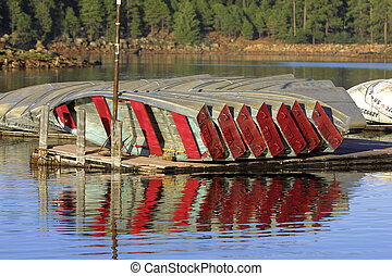 Boats at dock - Boats tied up at a dock on a rural lake with...