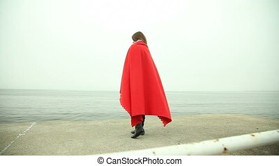 Lonely girl in red blanket sea - Lonely girl sad pensive...