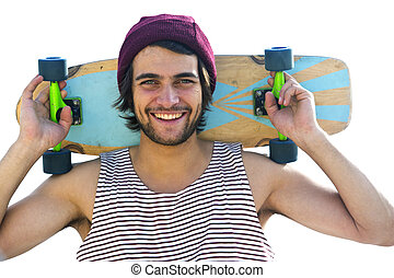 Skateboarder - Handsome skateboarder, smiling at the camera,...