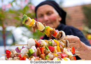 Elderly woman with fresh food - An old woman holding in her...