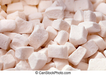 Tender white marshmallow pieces background - a sweet pile of...