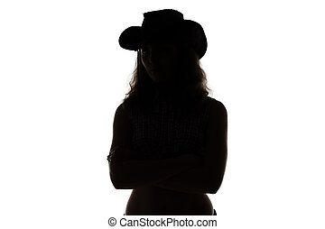 Silhouette of cowgirl