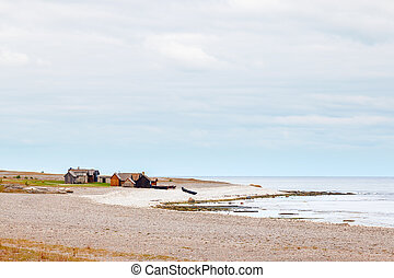 Shoreline of Gotland, Sweden with beach, water and fishing...