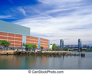 Manhattan. - East Harlem quay with old pier pylons and...