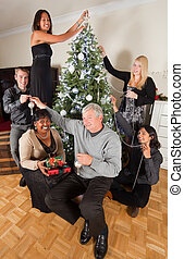 Christmas family tree - Cheerful family decorating the...