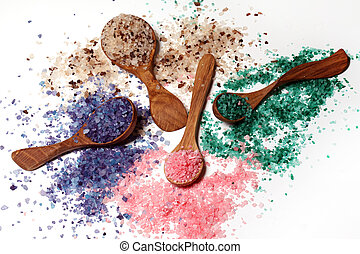 Colorful bath salt scattered over the white table