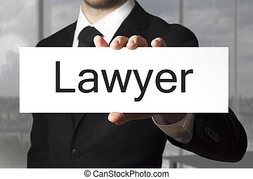 businessman holding sign lawyer - businessman in black suit...