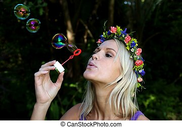 Pretty Bubble Blower Girl - Gorgeous blonde girl with flower...
