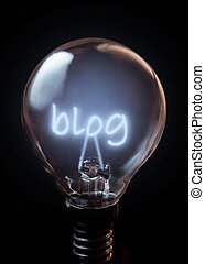 Blog illuminated bulb over a black background