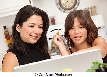 Attractive Hispanic Mother & Daughter on the Laptop