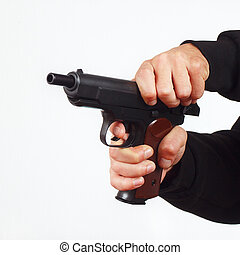 Hands reload semi-automatic pistol on white background -...