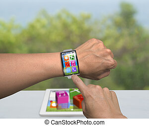 man hand wearing smartwatch with bent interface on tablet...