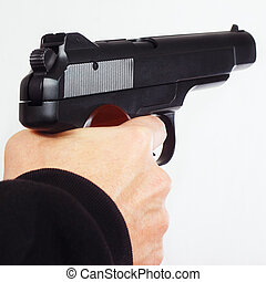 Hand with semi-automatic handgun on white background - Hand...
