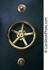 Vault door detail - Detail of antique vault door of bank...
